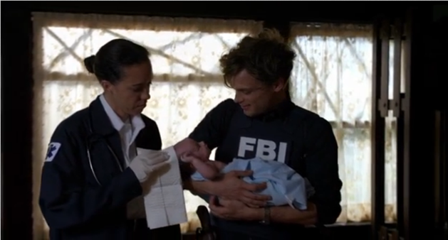 Matthew Gray Gubler as Spencer Reid holds the baby he just delivered.