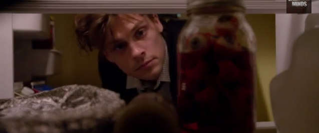 Reid examines Garcias fridge and finds suspicious eyeball jar.